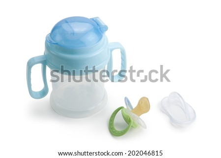 Bottle and pacifier,isolated on white background. - stock photo