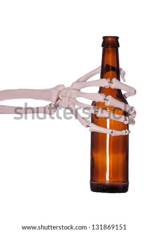 bottle and skeleton hand - stock photo