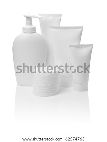 bottle and tubes with cotton pads