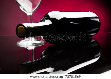 Bottle and wine glass in white back ground - stock photo