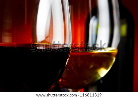 Bottle and wineglasses closeup - studio shot - stock photo