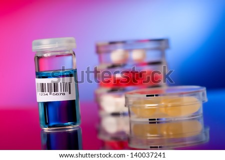 bottle barcode and petri dishes - stock photo