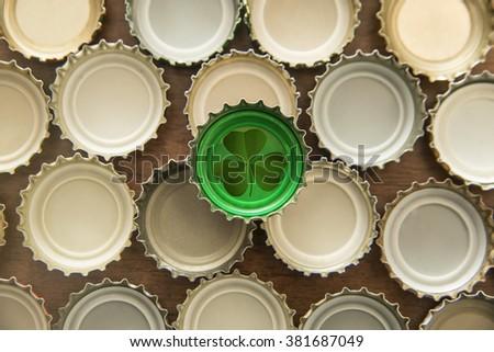 Bottle Cap Green isolated over many cork background - stock photo