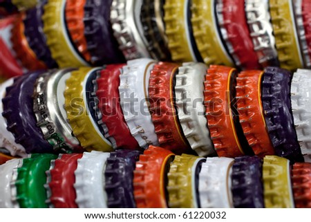 Bottle caps piled up in a row - stock photo