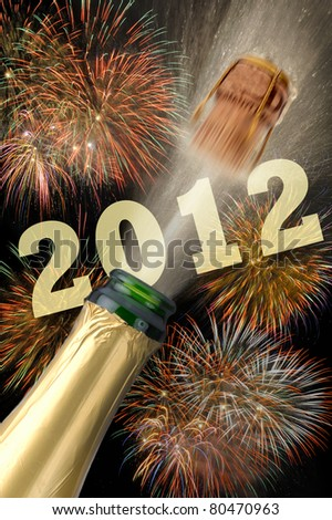 bottle champagne popping at new year 2012 - stock photo
