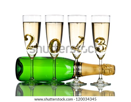 bottle  champagne with four glass goblet and  numeral 2013,  beautiful celebrations  New Year concept photo,  on white background; isolated - stock photo
