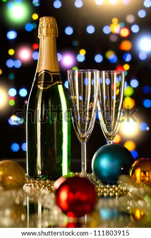 bottle  champagne  with two  glass goblet,  beautiful celebrations  New Year concept photo - stock photo