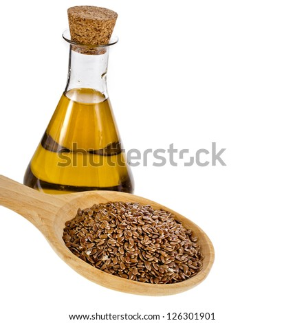 bottle flax seed oil isolated on white background - stock photo