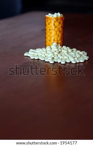 Bottle full of medicine - stock photo