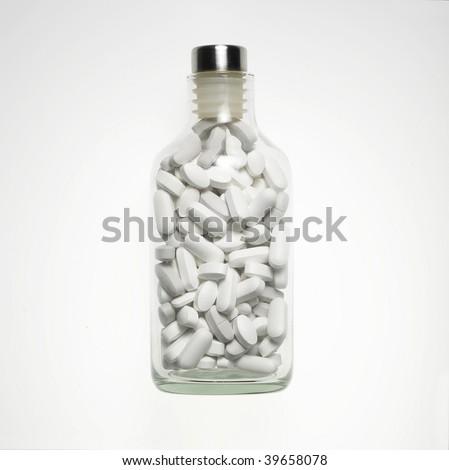 Bottle full of tablets - stock photo