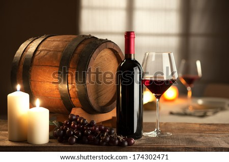 Bottle, glass, grape and barrel still life with restaurant on background. - stock photo
