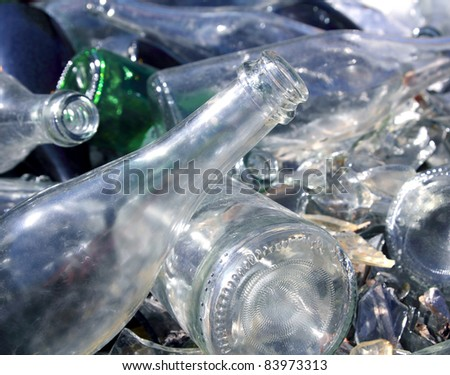 bottle glass in a recycle bin mound - stock photo