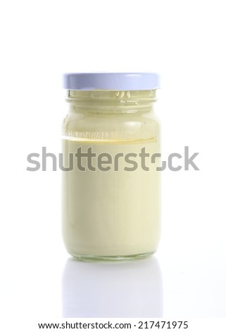 bottle glass of yellow color on white background