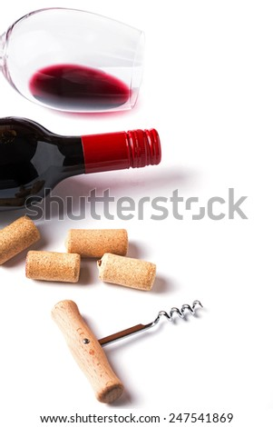 Bottle, glass with red wine, corks and corkscrew isolated on white background - stock photo