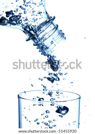bottle in pure water with waves and bubbles