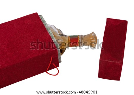 Bottle in the red velour box - stock photo