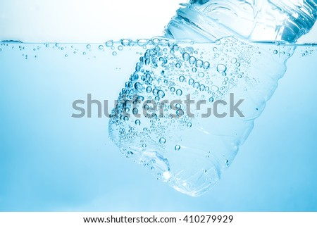 Bottle in under clean drinking water - stock photo