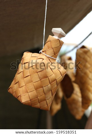 bottle made of birch bark hanging by a thread, handicraft  - stock photo