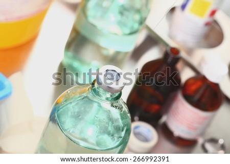 Bottle medicine in the hospital laboratory - stock photo