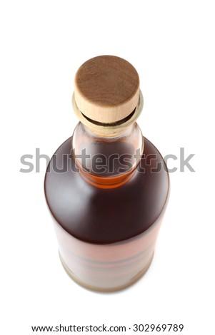 Bottle of alcoholic drink on white background - stock photo