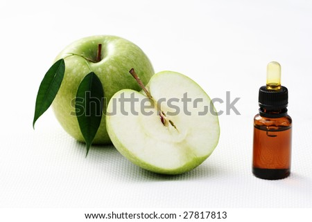 bottle of apple oil and fresh fruits - beauty treatment