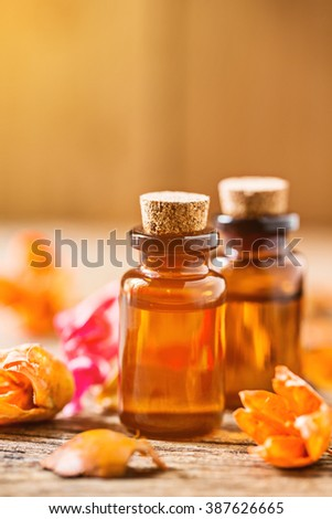bottle of aroma essential ,aroma oil on wooden table, spa or alternative medical concept. - stock photo