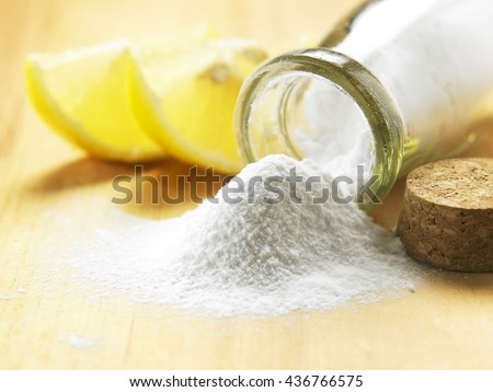 bottle of baking soda on the wooden table - stock photo