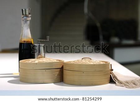 Bottle of balsamic vinegar, wooden boxes and pepper mill. - stock photo