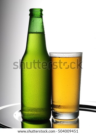 BOTTLE OF BEER AND GLASS
