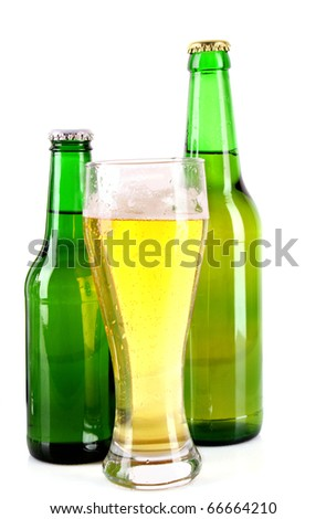Bottle of beer and mug isolated on white