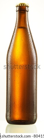 bottle of beer with drops - stock photo