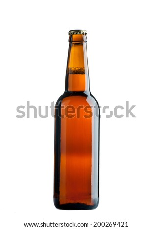 Bottle of beer with drops on white background. - stock photo