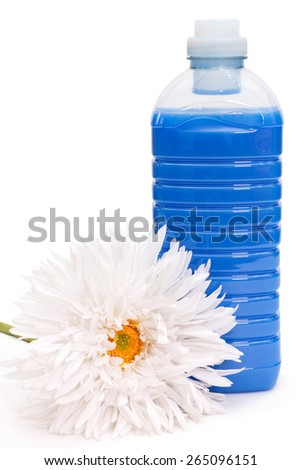 Bottle of blue fabric softener with white flower - stock photo