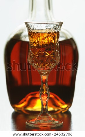 Bottle of brandy and glass - stock photo