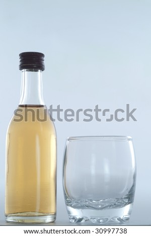 bottle of brandy with glass