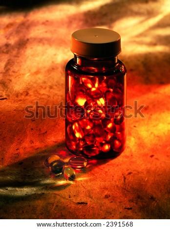 Bottle of capsules on warm mottles Background - stock photo