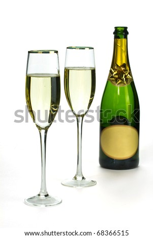 Bottle of champagne and champagne glasses isolated on white - stock photo