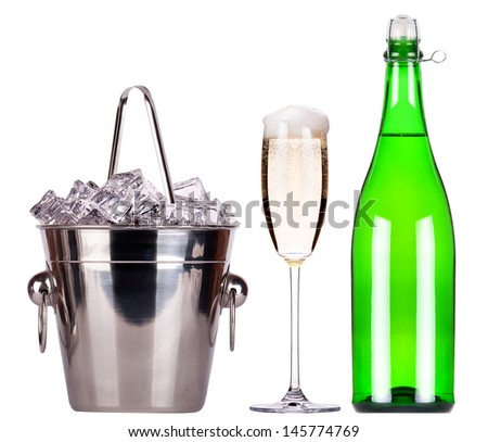 bottle of champagne and Metal ice bucket with glass isolated on a white baclground