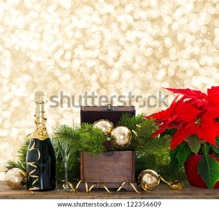 bottle of champagne and two glasses on shiny lights background. festive new years decoration - stock photo