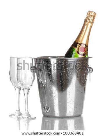 Bottle of champagne in bucket and goblets isolated on white - stock photo