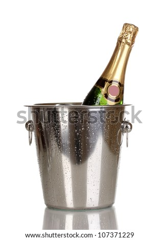 Bottle of champagne in bucket isolated on white - stock photo