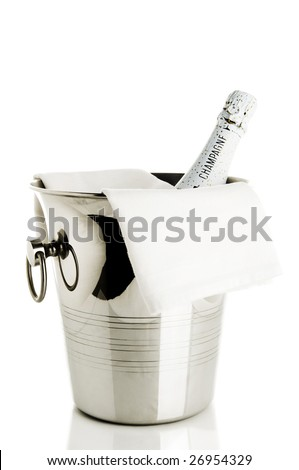 Bottle of champagne in ice bucket - stock photo