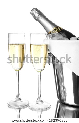 Bottle of champagne in pail and empty glasses, isolated on white - stock photo