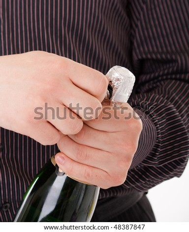 bottle of champagne in the hand - stock photo