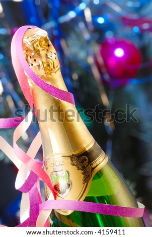 bottle of champagne on  background of  New Year tree - stock photo