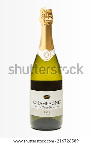 Bottle of champagne on white background - stock photo