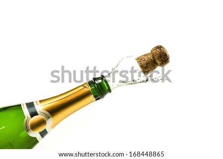 Bottle of champagne popping at new years eve - stock photo
