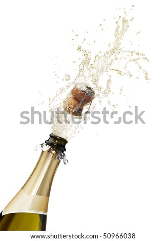 bottle of champagne popping its cork and splashing - stock photo