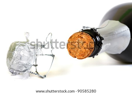 Bottle of champagne with cork over white background - stock photo
