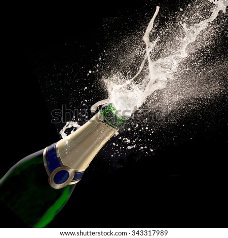 Bottle of champagne with wine explosion - stock photo